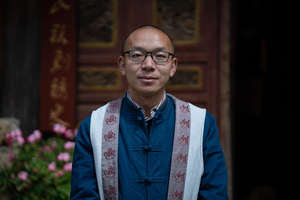 Wei Yuancai, the vice principle of Baisha Naxi Embroidery Institute and the Secretary General of Lijiang Taiji Association