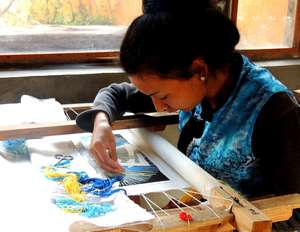 Yang Guifen,Naxi Nationality, Senior embroiderer of Baisha Naxi Embroidery Institute