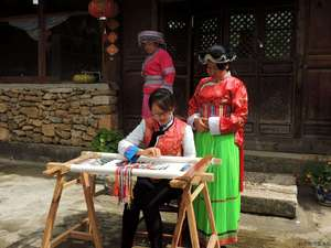 Kang Yanping, Embroidery master and Senior culture teacher of Baisha Naxi Embroidery Institute